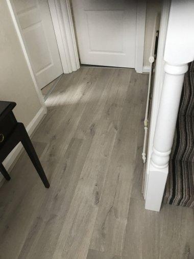 Quickstep Laminate flooring to hallway and Durham stripe carpet to stairs